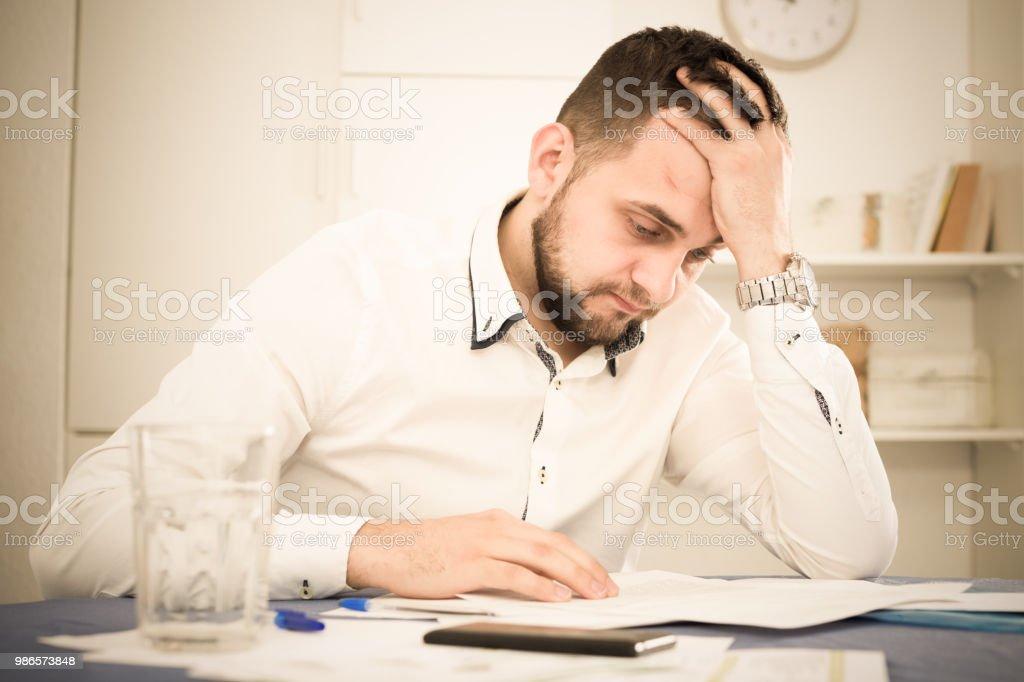 Man struggling to pay bills stock photo