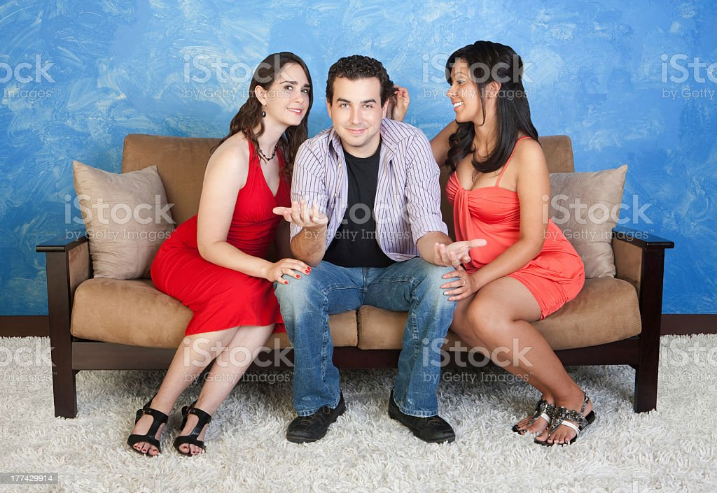 A Man Stuck In The Middle Of Two Women A Love Triangle Stock Photo -  Download Image Now - iStock