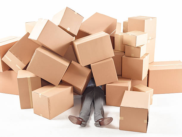 man stuck under the with boxes - trap house stock pictures, royalty-free photos & images