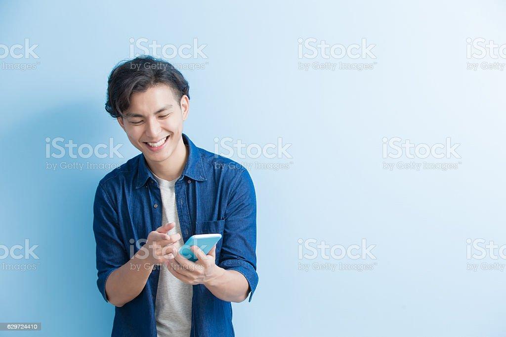man student use phone stock photo