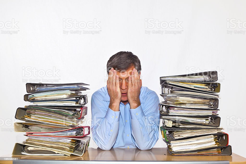 man studies folder with files at his desk royalty-free stock photo