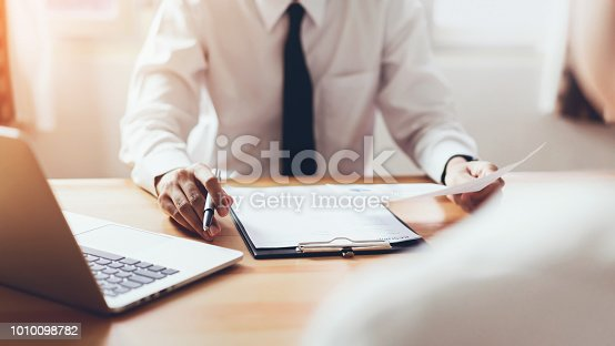 istock man submit resume to employer to review job application. The concept presents the ability for the company to agree with the position of the job. 1010098782