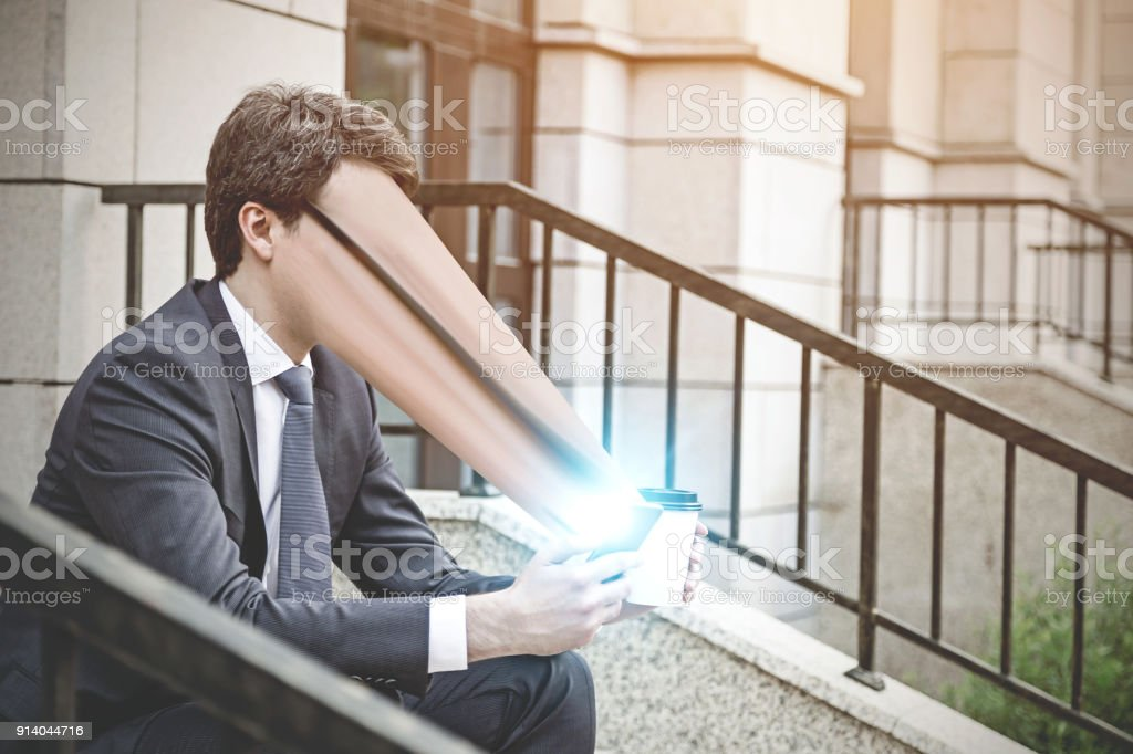 Man sucked into a smartphone stock photo