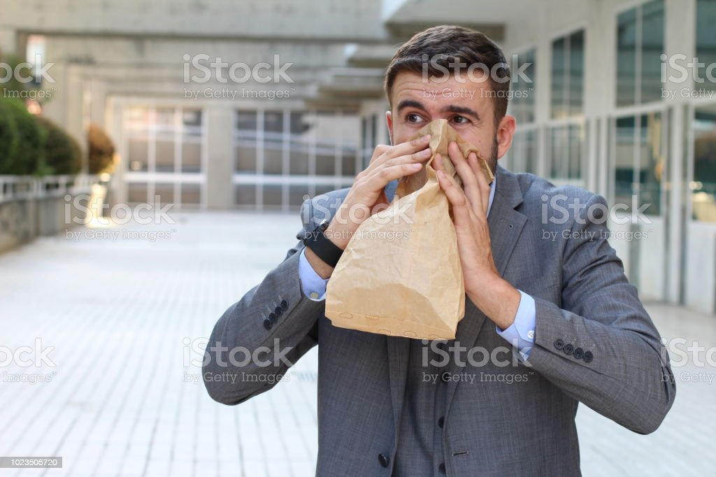 Man suffering an unpleasant smell at work stock photo