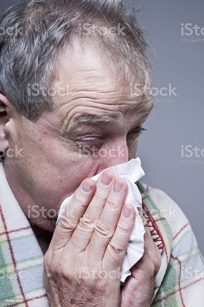 Man Suffering From A Cold Blowing His Nose royalty-free stock photo