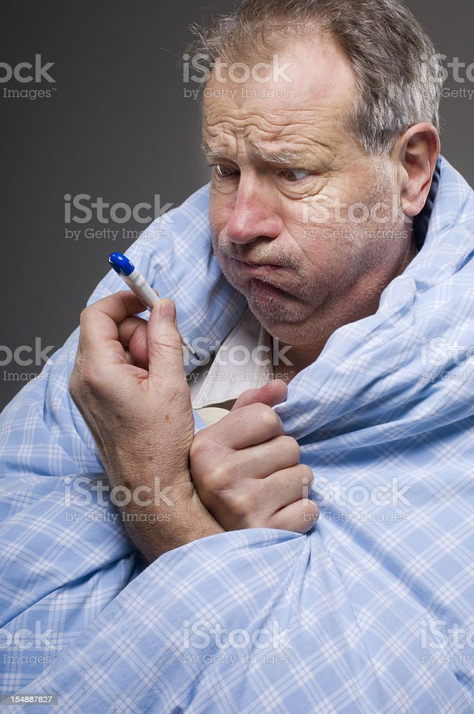 Man Suffering From A Cold Shocked Taking His Temperaure stock photo