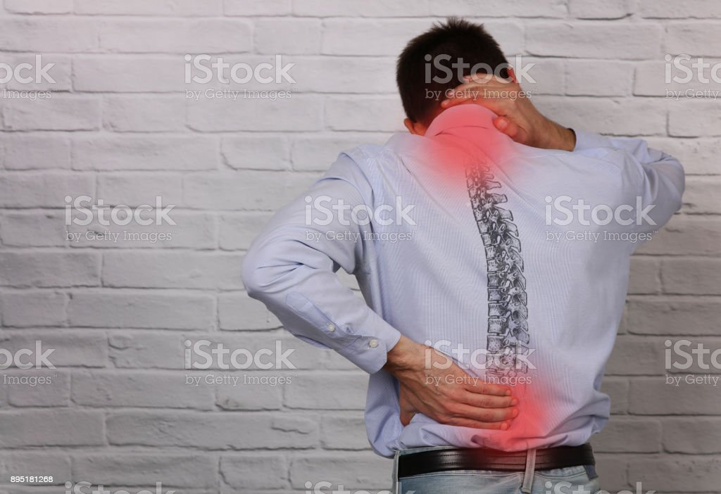 Man suffering from back and neck pain. Incorrect sitting posture problems, Muscle spasm, rheumatism. Pain relief , chiropractic concept. stock photo