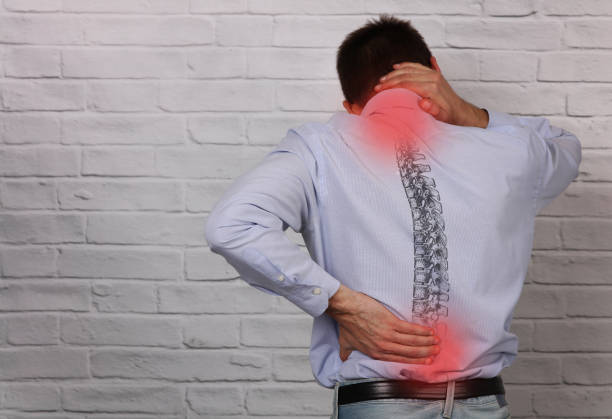 man suffering from back and neck pain. incorrect sitting posture problems, muscle spasm, rheumatism. pain relief , chiropractic concept. - chiropractic care stock photos and pictures