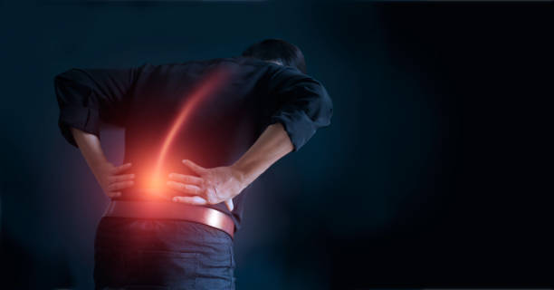 Man suffering from back pain cause of office syndrome, his hands touching on lower back. Medical and heath care concept Man suffering from back pain cause of office syndrome, his hands touching on lower back. Medical and heath care concept back pain stock pictures, royalty-free photos & images