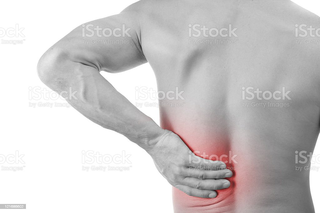 A man suffering from back pain stock photo