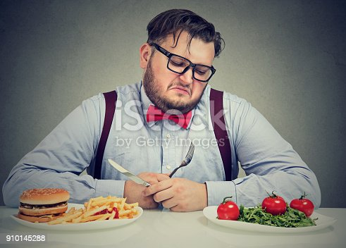 1067846662 istock photo Man suffering from diet choice 910145288