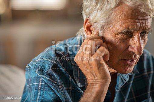 1029343276 istock photo Man suffering from ear ache 1256273598