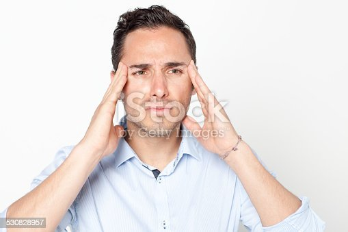 534891769 istock photo Man suffering from headache 530828957