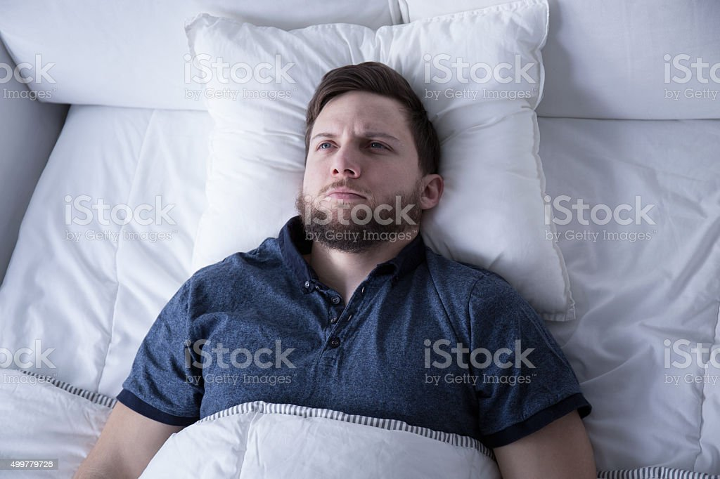 Man suffering from insomnia stock photo