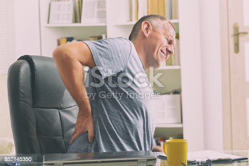 istock Man suffering from low back pain 852145350