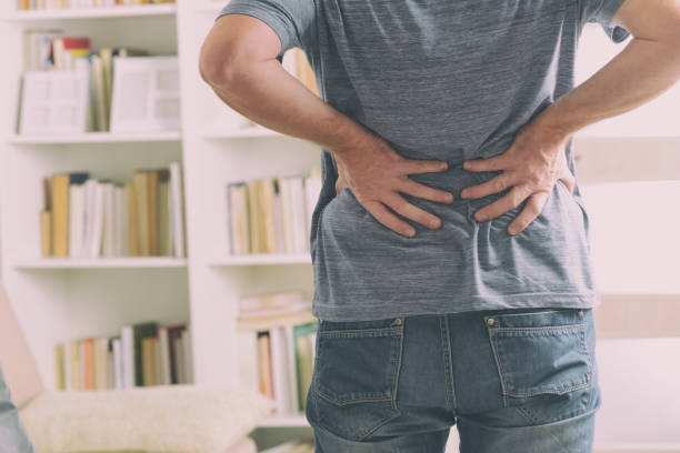 Man suffering from low back pain stock photo
