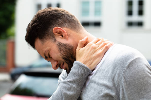 Man Suffering From Neck Pain stock photo