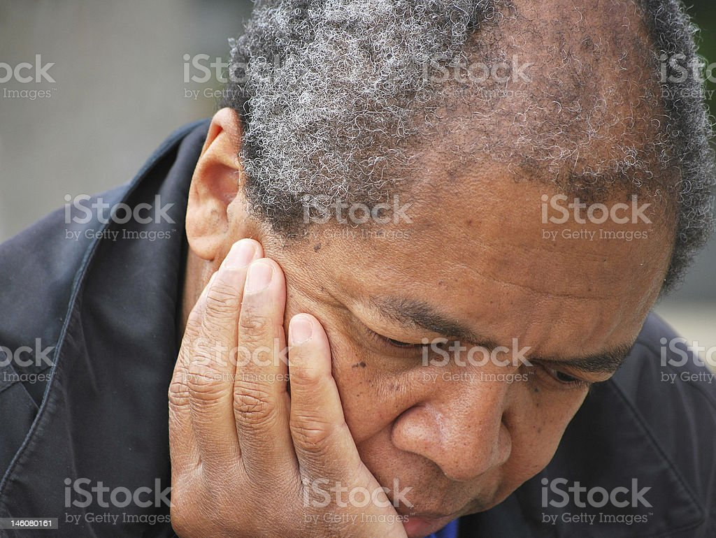 A man suffering from severe depression stock photo