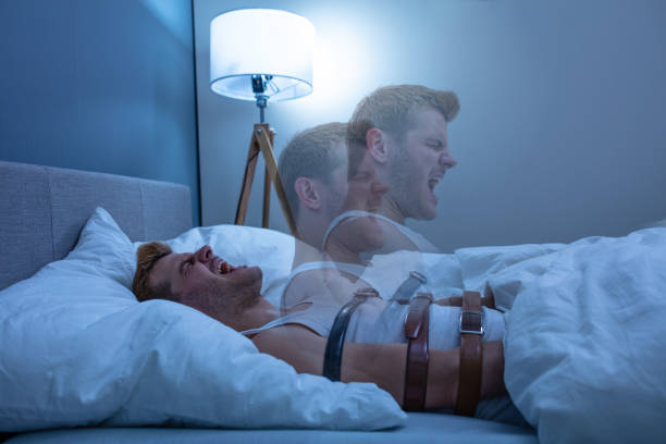 Man Suffering From Sleep Paralysis Man Suffering From Sleep Paralysis At Home paralysis stock pictures, royalty-free photos & images