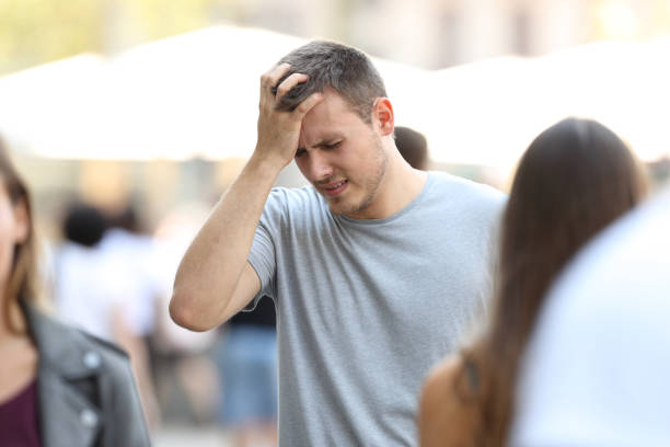 Man suffering head ache on the street stock photo