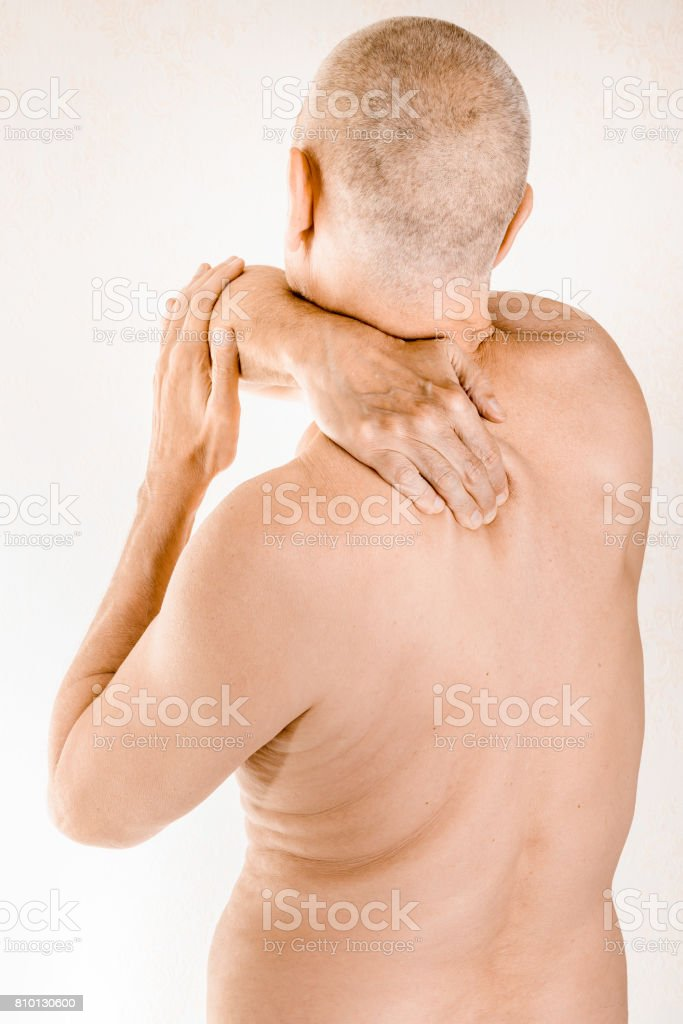 Man Suffering Of Thoracic Vertebrae Or Trapezius Muscle Pain Stock