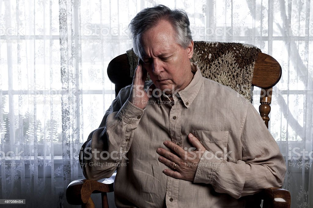 Man Suffering with Chest and Head Pain stock photo