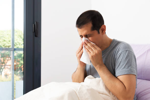 man suffering with the flu stock photo