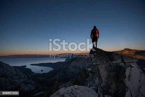 Man summiting a beautiful mountain top in Lake Tahoe, California