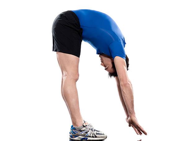 man sun salutation yoga surya namaskar pose workout  touching toes stock pictures, royalty-free photos & images