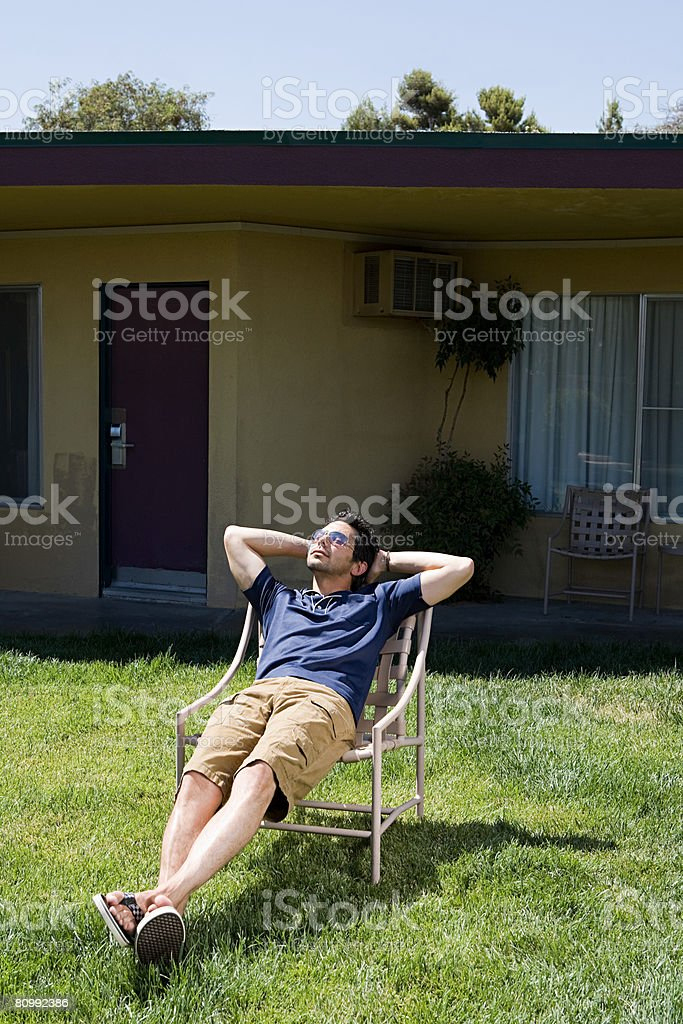 Man sunbathing at motel royalty-free stock photo
