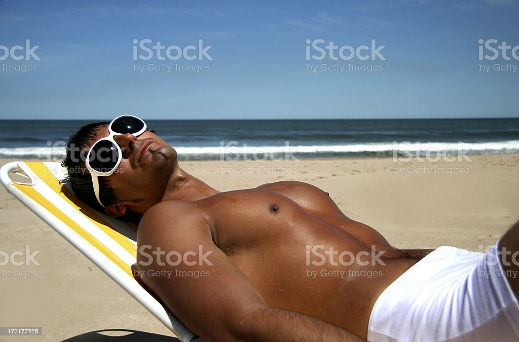 Man Sunbathing on the Beach royalty-free stock photo