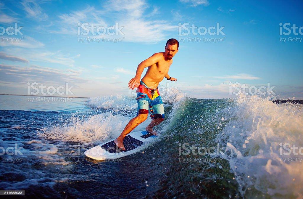 Man surfboarding stock photo