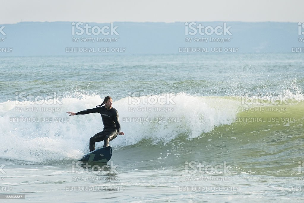 Man Surfing in Croyde Bay Devon stock photo