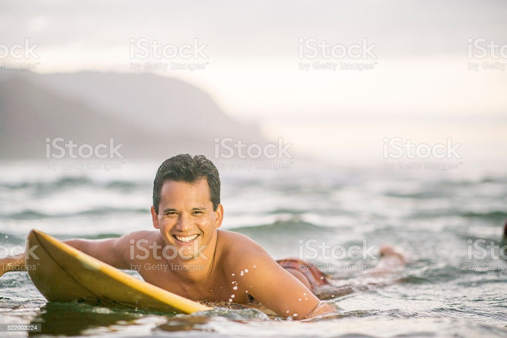 Man Surfing in Hawaii stock photo