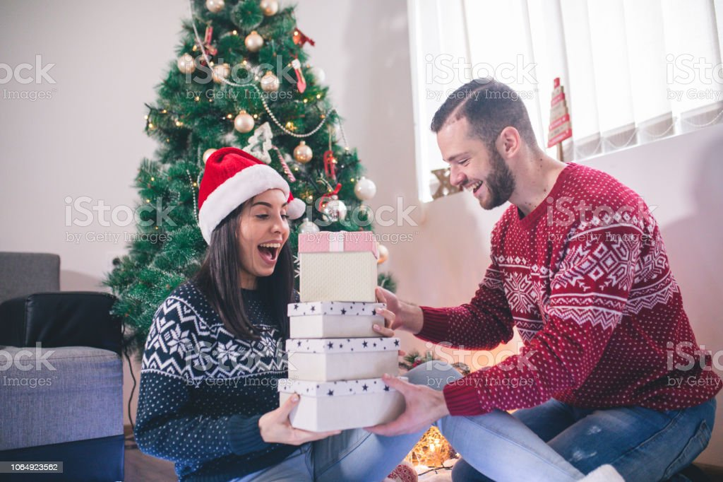Man surprise woman for Christmas