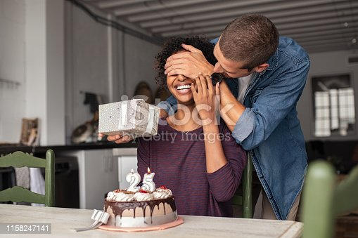 istock Man surprising girl on birthday 1158247141