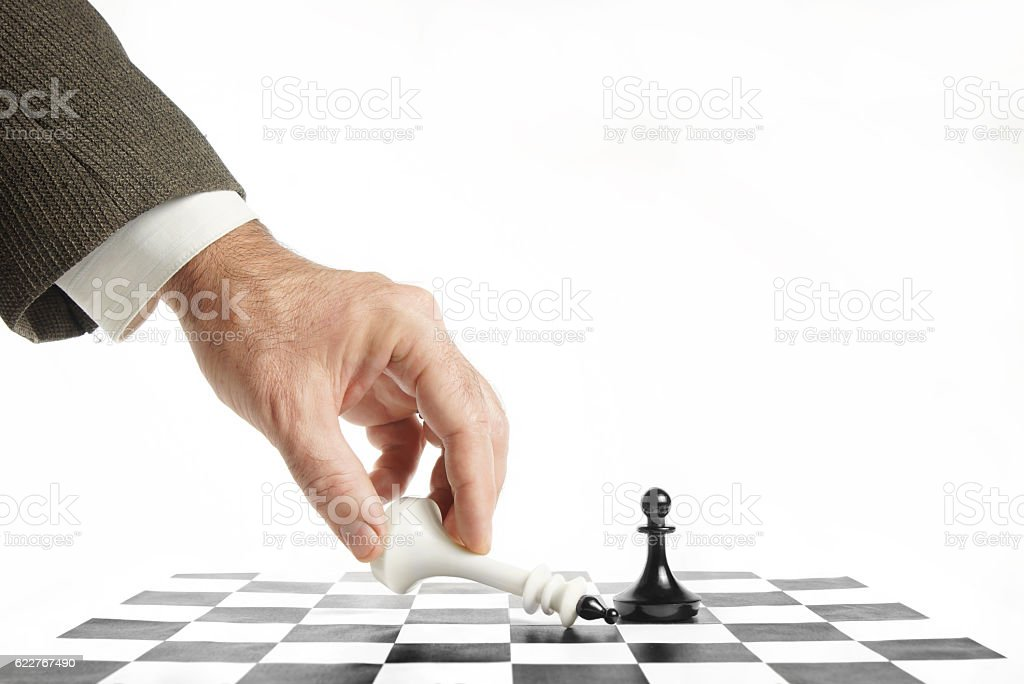 Man surrenders in chess game. Concept of losing and failure stock photo