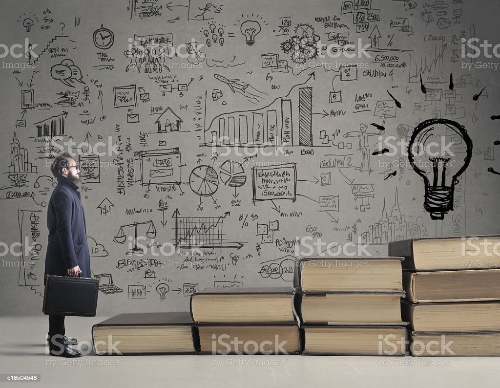 Man surrounded by ideas stock photo