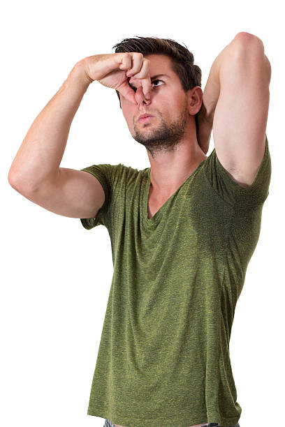 Man sweating very badly under armpit and pointing there stock photo
