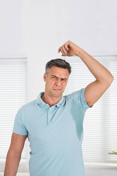 Man Sweating Very Badly Under Armpit stock photo