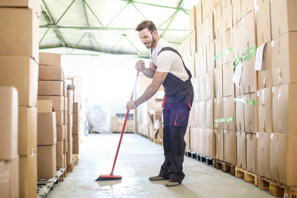 man sweeping the warehouse floor - sweeping stock pictures, royalty-free photos & images
