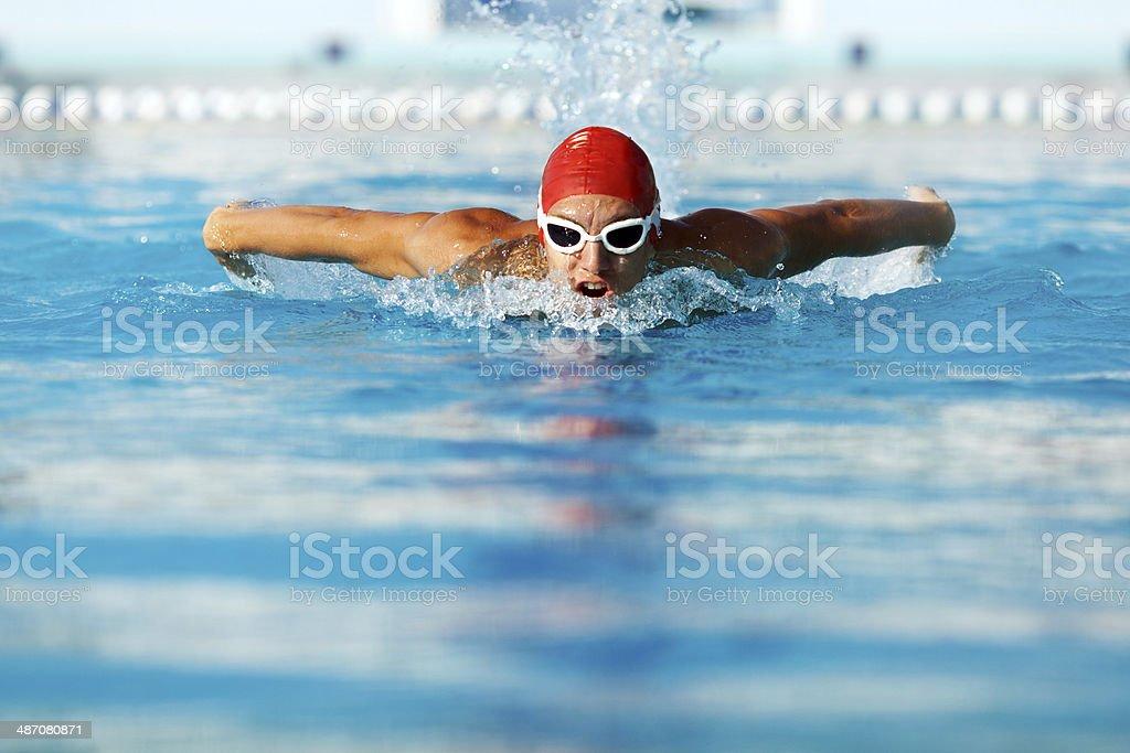 Man swimming butterfly stroke style stock photo