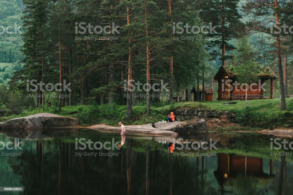 Man swimming in scenic lake in Norway stock photo