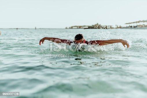 istock Man swimming on the Crete Island 995002128