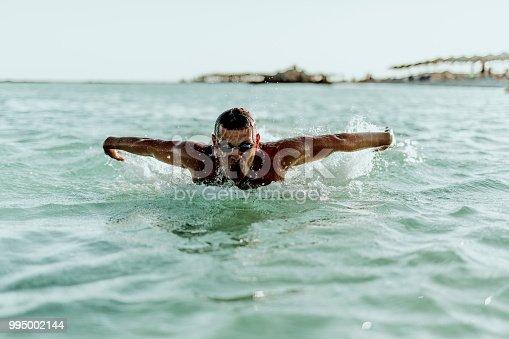 istock Man swimming on the Crete Island 995002144
