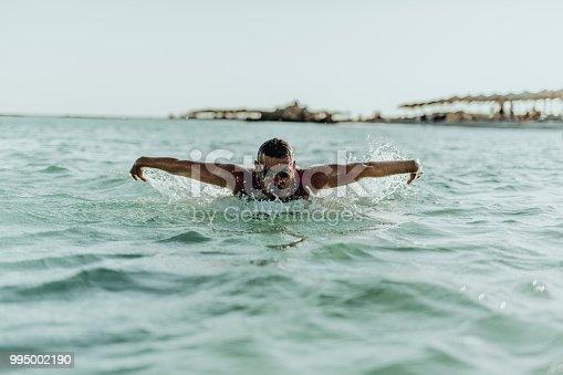istock Man swimming on the Crete Island 995002190
