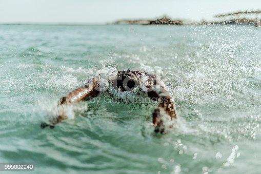 istock Man swimming on the Crete Island 995002240