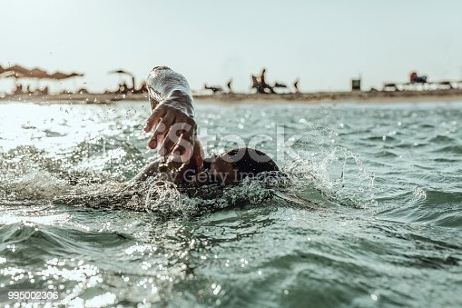 istock Man swimming on the Crete Island 995002306