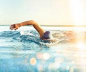 Man Swimming outdoors