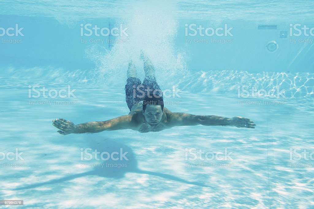 Man swimming under water royalty-free stock photo